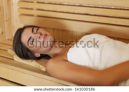 Beauty young woman resting in sauna   - stock photo