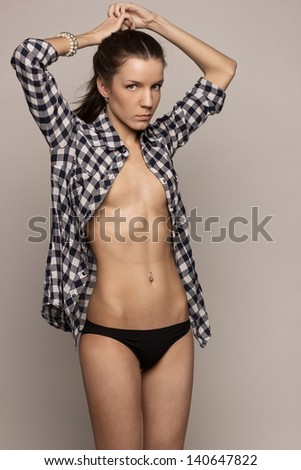 beauty young woman topless posing in shirt - stock photo