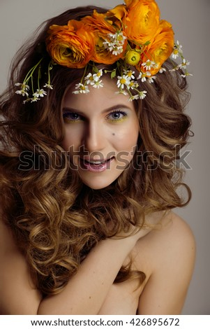 Beauty young woman with flowers and make up close up, real spring beauty girl - stock photo