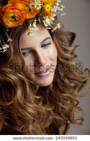Beauty young woman with flowers and make up close up, real spring beauty girl curly hair, sweet - stock photo