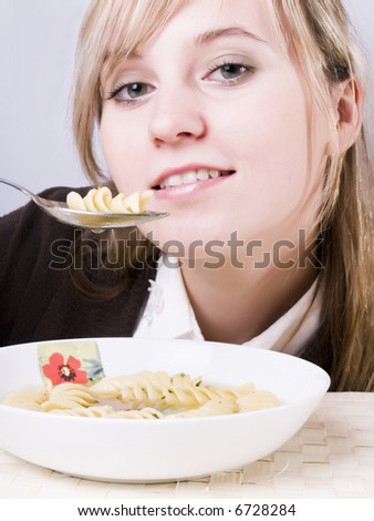 beauty young women eating delicious soup