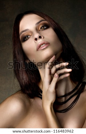 Beautyful dark hair girl with necklace - stock photo