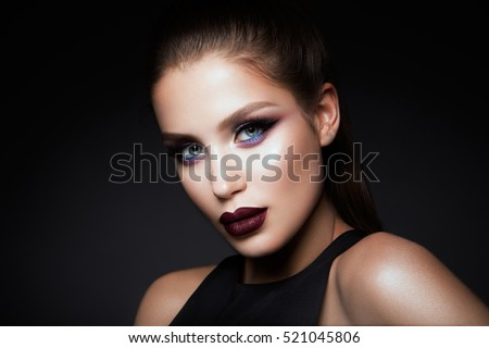 Beautyful girl with bright make up and beautiful hairstyle