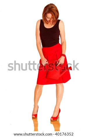 Beautyful woman with red skirt and bag - stock photo