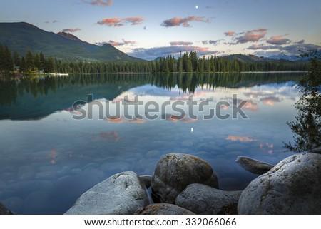 Beauvert Lake or Lac Beauvert near Jasper National park Alberta Canada. Photo taken just after Sunset - stock photo