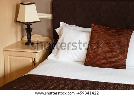 Bed and breakfast generic room with detail of bed, sheets and bedside cabinet great for any guest house.