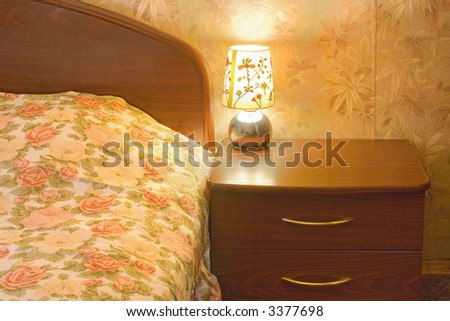 Bed and lamp, night, interior - stock photo