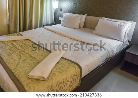 Bed in a business hotel room.