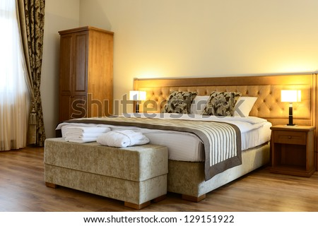 bed in a hotel number - stock photo