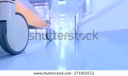 Bed in hospital corridor - stock photo