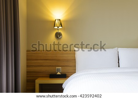 Bed in hotel room with pillows