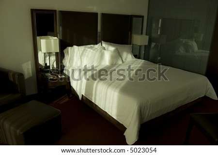 Bed in luxury room hotel - stock photo