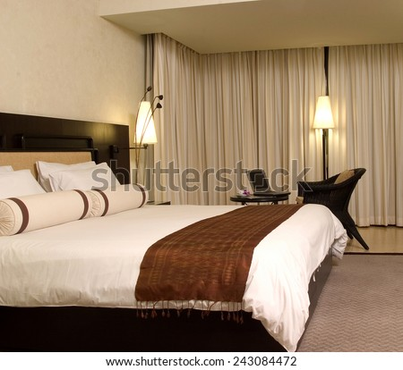 bed in the modern interior room - stock photo