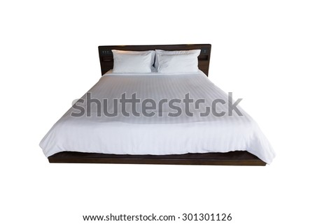 Bed. Isolated against white background with path  - stock photo
