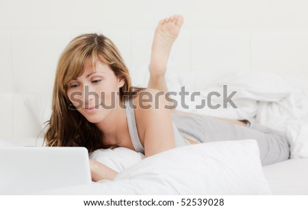 Bed lying web browsing female
