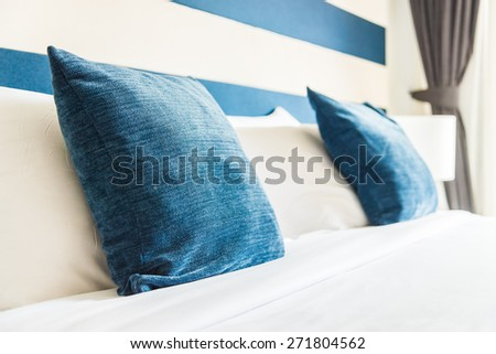 Bed pillow in luxury hotel - vintage film tone effect style processing - stock photo