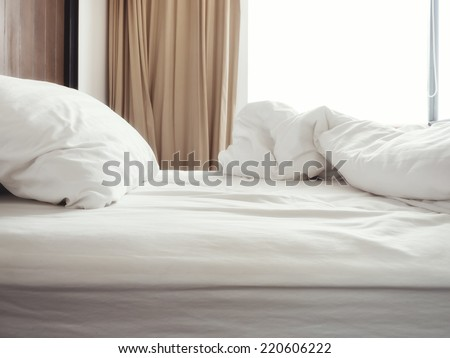 Bed sheet and pillow messed up in the morning - stock photo