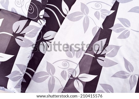 Bed spreads for background. - stock photo