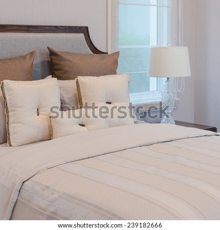 bed with pillows and blanket in bedroom at home - stock photo