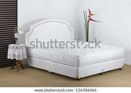 Bedding mattress in a set up bedroom atmosphere - stock photo
