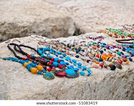 Bedouin necklaces. Jerash street market. Shallow depth of field. - stock photo