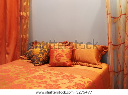 Bedroom decorated in shades of orange - home interiors - stock photo
