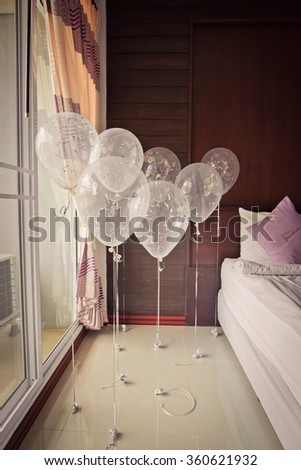 Bedroom full of colorful balloons - stock photo