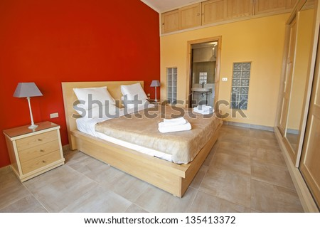Bedroom in a luxury apartment show home with interior design - stock photo