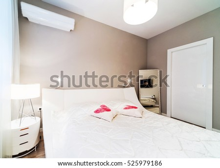 Bedroom interior in light tones with white furniture