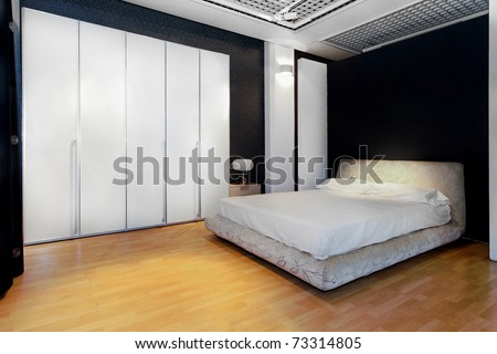 Bedroom interior with big white wardrobe closet - stock photo