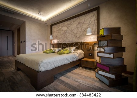 Bedroom interior with double bed and chabby chic style commode - stock photo