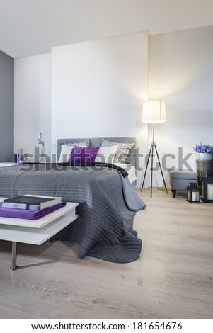 Bedroom interior with gray bed - stock photo