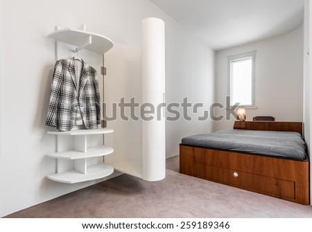 Bedroom interior with modern closet - stock photo