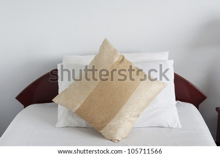 Bedroom interior with single brown pillows - stock photo