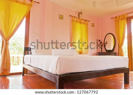 Bedroom on holiday at resort - stock photo