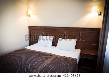 Bedroom Two Beds.Luxury Bedroom.Sleeping Hotel Suite.Hotel Suite.Cozy Bedroom.Hotel Bedroom.Double Bed.Wooden Double Bed.Classic Wooden Bed. - stock photo