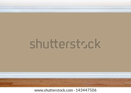 Bedroom wall with baseboard and crown molding - stock photo