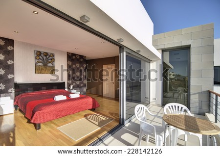 Bedroom with balcony in the modern villa with sea view  - stock photo