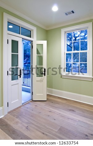 bedroom with double doors open to porch - stock photo