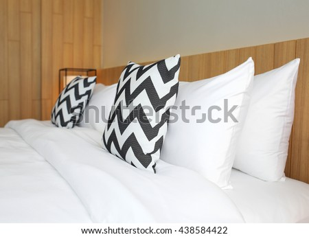 bedroom with pillows on bed at home - stock photo
