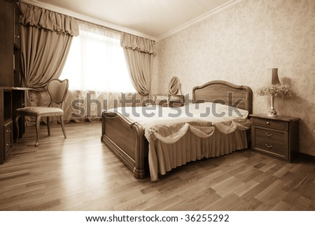 Bedroom with the lamp in modern apartment - stock photo