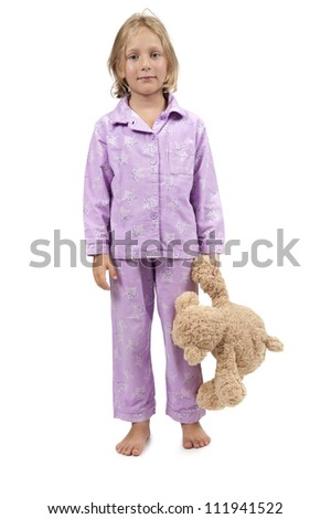 Bedtime child in pajamas with teddy bear stock photo