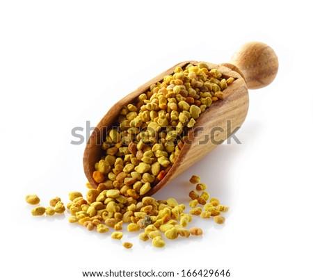 bee pollen in a wooden scoop - stock photo