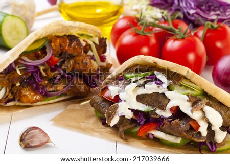 Beef and Kebab in a bun with garlic sauce - stock photo