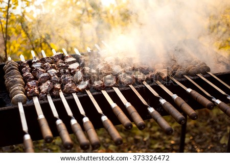 beef and pork steak bbq on the grill  - stock photo