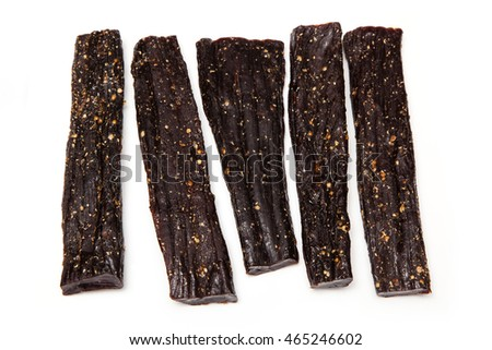 Beef Biltong sticks, Bitoning is traditional South African beef jerky. Isolated on a white studio background.