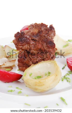 beef bourguignon in wine with artichoke and marinated vegetables on white plate isolated over white background - stock photo