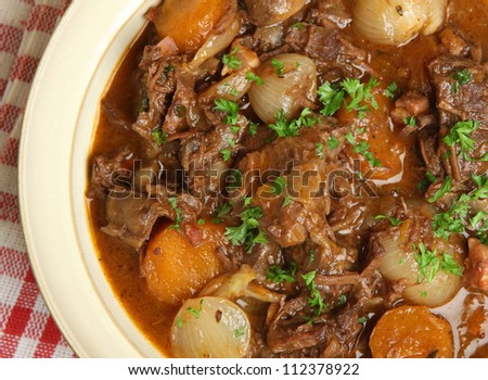 Beef bourguignon, traditional French stew with lardons, carrots, mushrooms and shallots. - stock photo