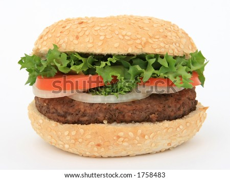 Beef burger in a bun, over white, with lettuce salad, tomato, onion, close up, macro - stock photo