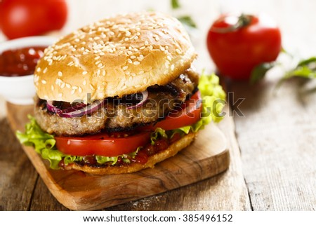 Beef burger on desk - stock photo
